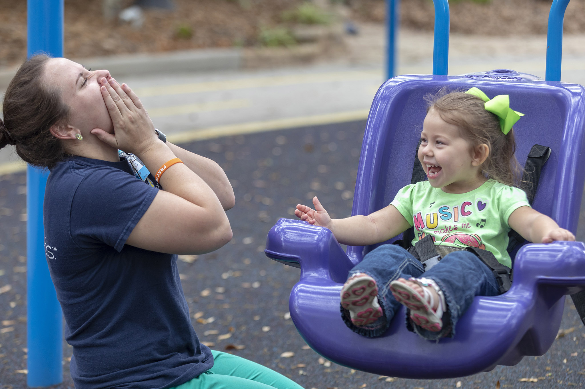 Brianna Rizzo, a speech pathologist at Johns Hopkins All Children's Hospital, works with Iva.