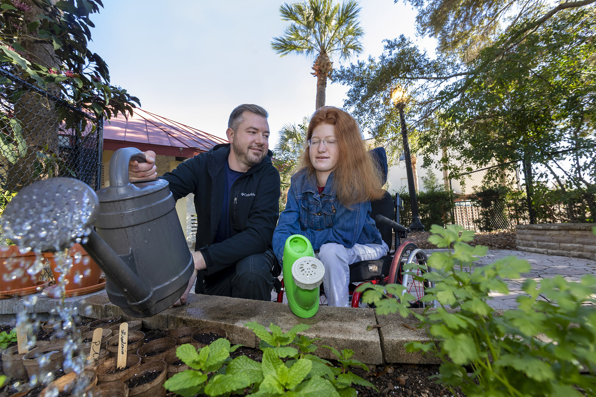 13-year-old Kelly and her therapist Nick Hamilton, are bringing this small garden at the hospital's therapy playground back to life.