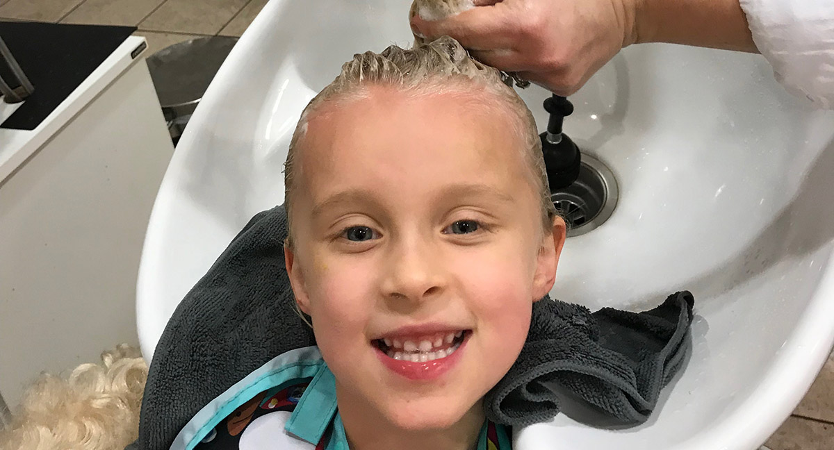 Audrey, 5, gets her hair cut. She works with occupational therapists and speech pathologists at Johns Hopkins All Children's.