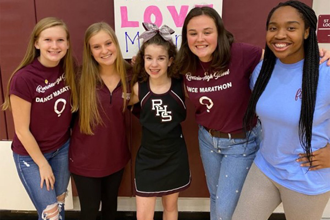 Marina (center), a patient at Johns Hopkins All Children's, became an honorary cheerleader and helped raise money for the hospital at Sarasota Riverview High's Dance Marathon.