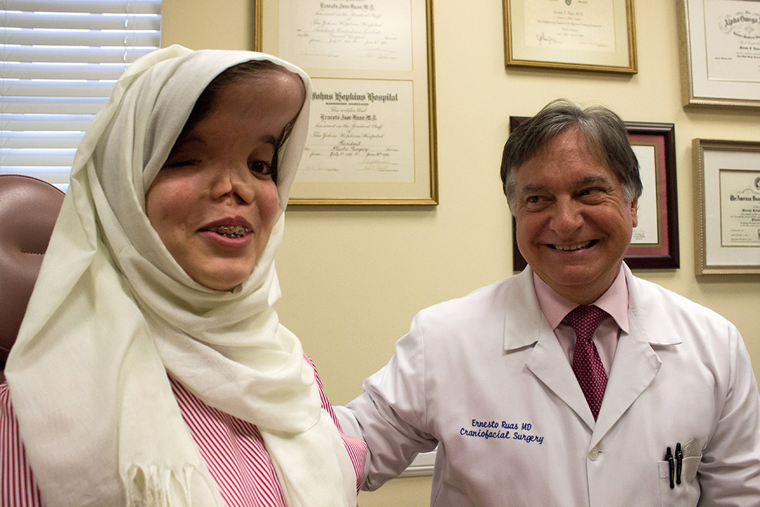 Fatima with Ernesto Ruas, M.D., a plastic surgeon at Johns Hopkins All Children's Hospital