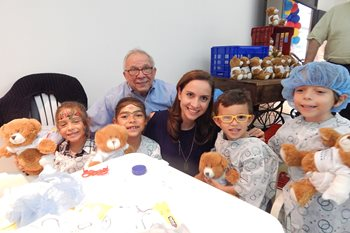 Roberto Sosa, M.D., medical director of the International Program at Johns Hopkins All Children's Hospital, with children he has cared for, from his native Guatemala.