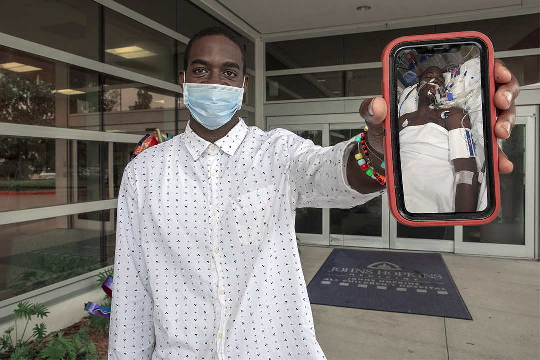 Charles Bentley with a photo from when he was brought to Johns Hopkins All Children's with a gunshot wound two years ago.