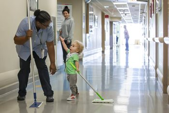 Patient Rocco with environmental services worker Thelma at Johns Hopkins All Children's