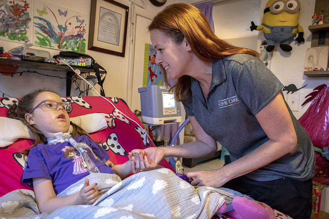 Tina Gray, RRT, a respiratory therapist from Johns Hopkins All Children's Home Care, visits with Amiya in her home.