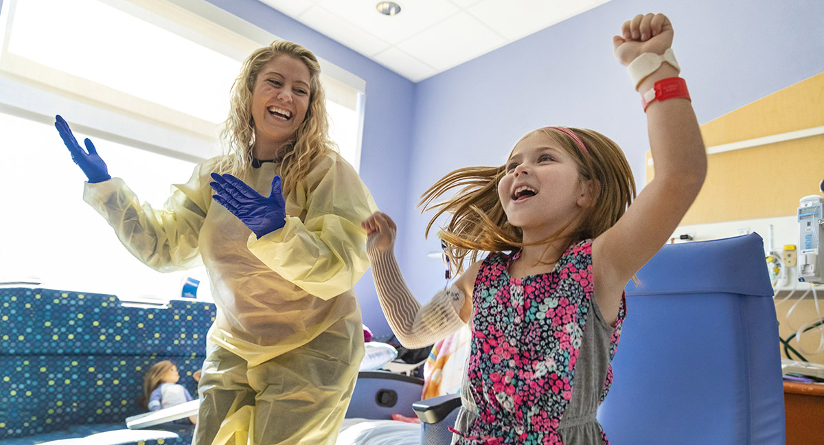 7-year-old Kelsie celebrates completion of her math lessons with some lively dancing.