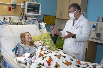 Ashley with Dr. George Jallo at Johns Hopkins All Children's in early October.