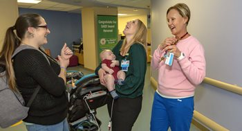 Joshua and his mom Christina visit neonatal intensive care unit nurses Misti Moore, R.N., and Amber Tenholder, R.N., at Johns Hopkins All Children's Hospital