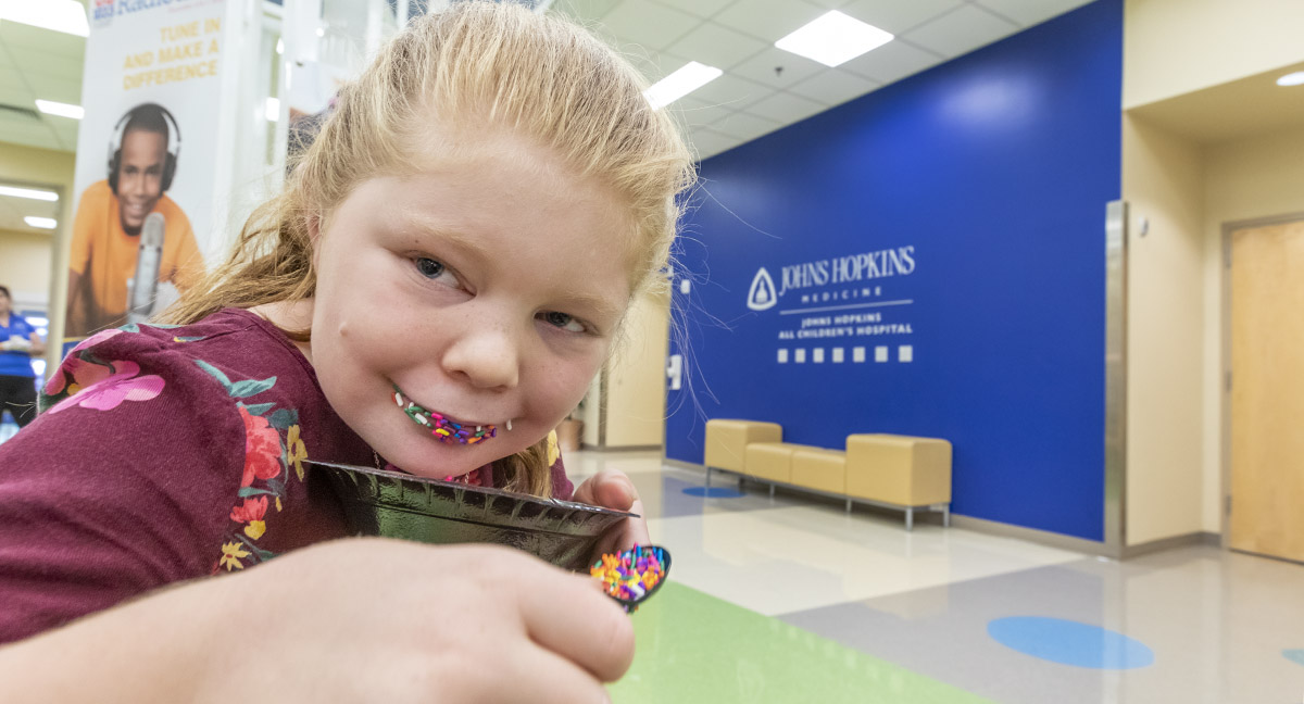 Isabella eats a bowl of sprinkles at the Family Advisory Council's ice cream social at Johns Hopkins All Children's Hospital