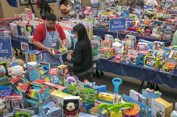 All Kids Wonderland volunteers help parents pick out holiday gifts for patients and siblings at Johns Hopkins All Children's Hospital