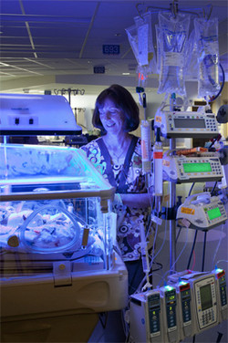 NICU Nurse at bedside